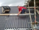 Mark Todd oversees the final stage of a Solar panel installation 1
